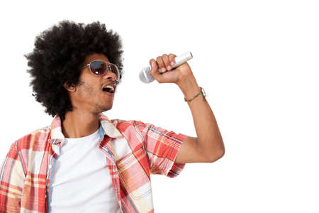 Black man holding a microphone and singing - isolated over a white background   photo