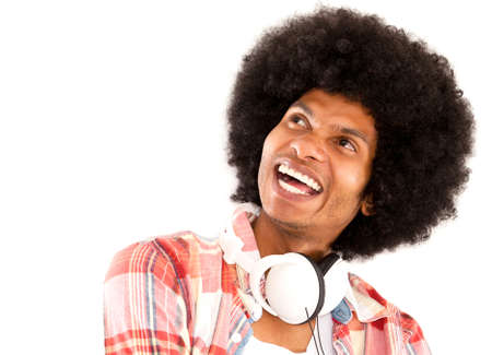 Happy afro man with headphones laughing - isolated over a white background  photo