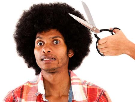 Afro Mann ungern seine Haare schneiden - �ber einen wei�en Hintergrund isoliert Lizenzfreie Bilder