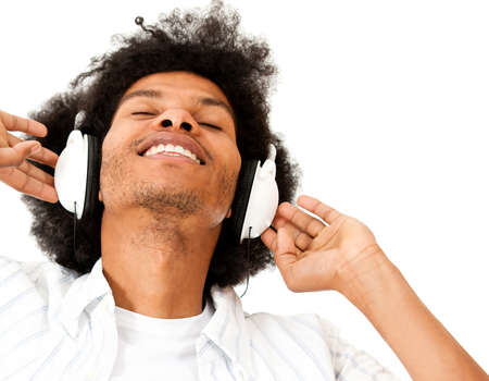 Afro man enjoying listening to music  - isolated over a white background   photo