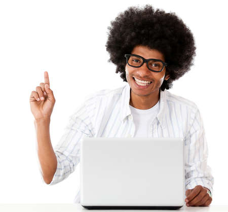 Geek with a laptop pointing an idea - isolated over a white background  photo
