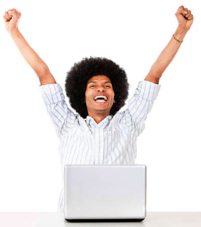 Successful man on a laptop computer - isolated over a white background  photo