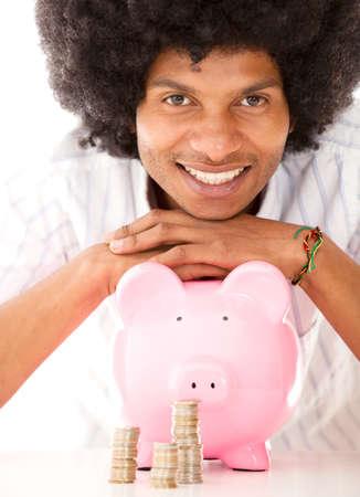 coinbank: Hombre negro con una hucha - aislados en un fondo blanco Foto de archivo