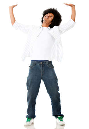 Black man lifting something  imaginary - isolated over white background  photo