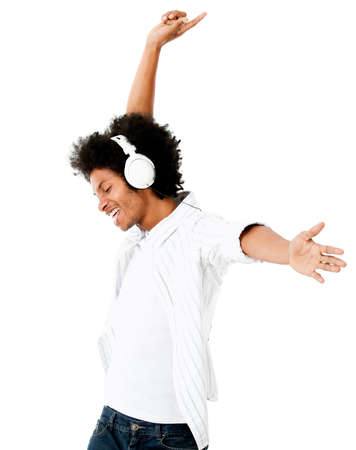 music listening: Black man having fun listening to music - isolated over a white background