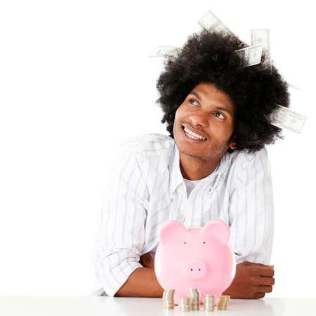 coinbank: Hombre pensativo rico pensando c�mo gastar el dinero - aislado Foto de archivo