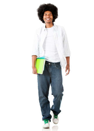 Black male student walking - isolated over a white background  photo
