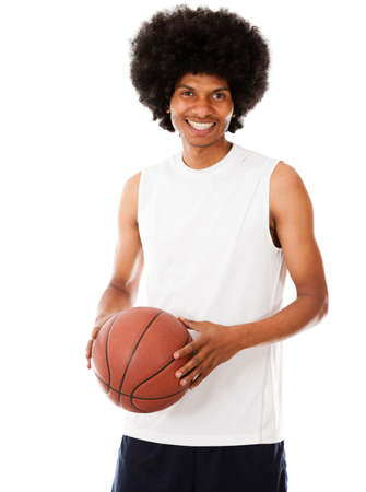 Happy basketball player holding the ball - isolated over a white background  photo