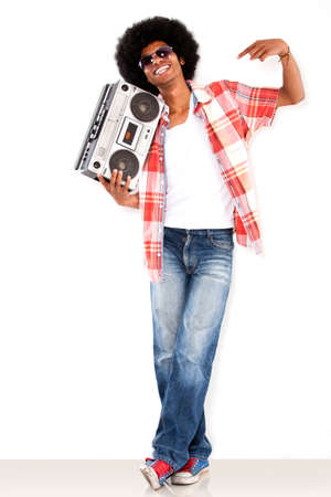 messy hairstyle: Happy black man with a radio enjoying the music   Stock Photo