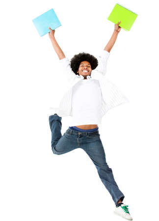 Happy black student jumping of excitement - isolated over a white background   photo