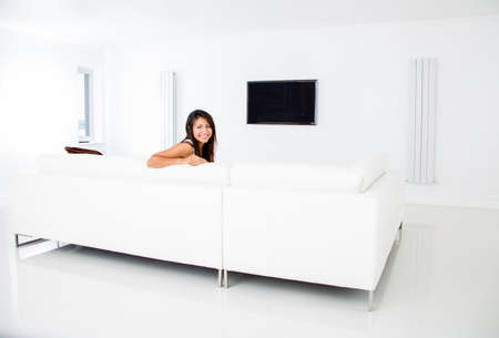 Woman at home watching tv in the living room  Stock Photo - 15101063