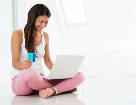Happy woman shopping online with a credit card Stock Photo - 15165601