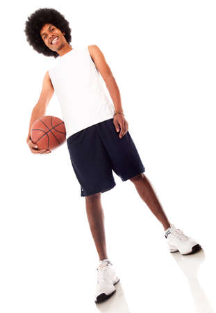 Man holding a basketball ball - isolated over a white background  photo