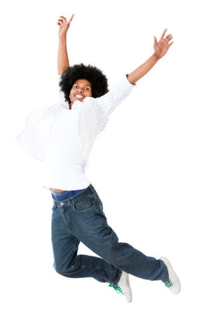 afro hairdo: Casual black man jumping - isolated over a white background
