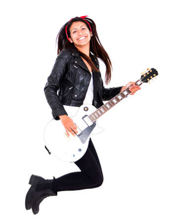 Female guitar player jumping - isolated over a white background  photo