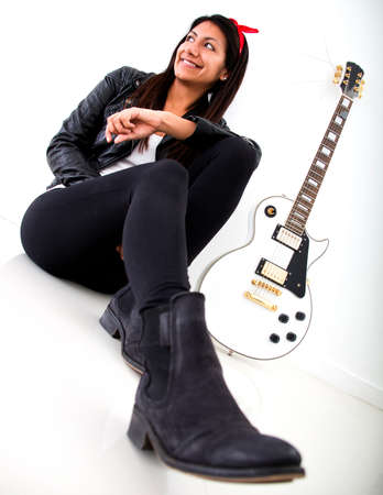 Woman with an electric guitar - isolated over a white background  photo
