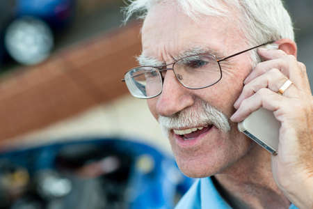 Elder man talking on his mobile phone  photo
