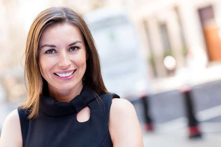 female executive: Portrait of a successful woman in the city looking happy  Stock Photo