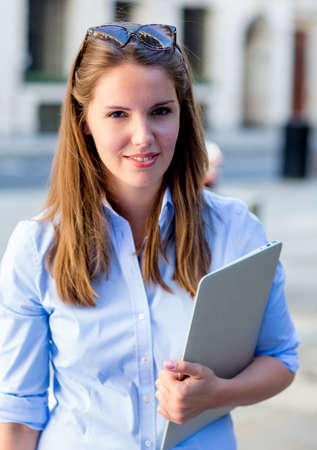 Beautiful female student with a laptop at the university   Stock Photo - 15503056