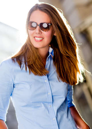 chic woman: Beautiful summer woman wearing chic sunglasses looking happy