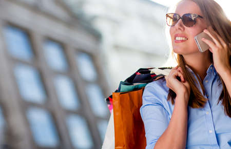 Beautiful woman shopping and talking on the phone  Stock Photo - 15503049
