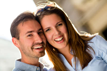Portrait of a loving couple looking very happy and smiling  Stock Photo - 15503059