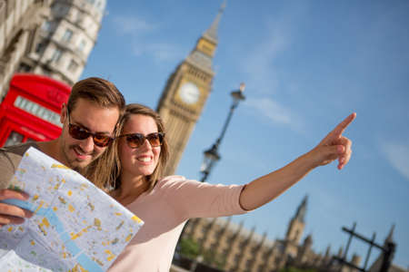 lost love: Couple of tourists in London holding a map
