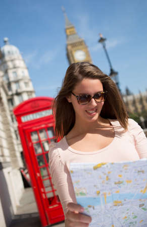 Woman walking as a tourist in London with a map  photo