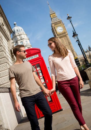 Romantic couple walking in London holding hands  photo