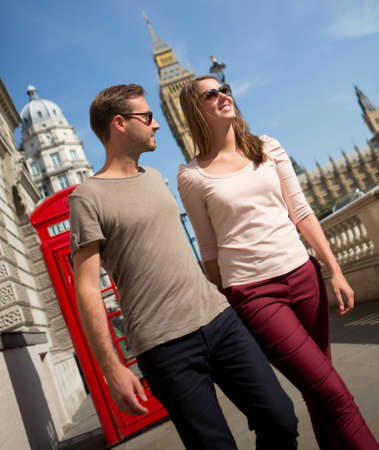 Romantic couple walking the streets of London on a summery day  photo