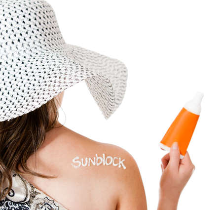 sunblock: Summer woman wearing sunblock to protect her sking - isolated over white