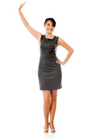 arms  outstretched: Business woman holding something up with her hand - isolated over white