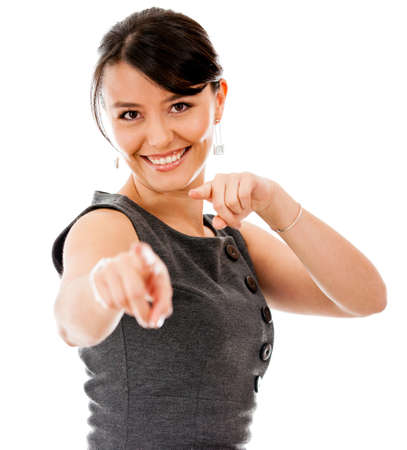 Happy business woman pointing at the camera - isolated over a white background  photo