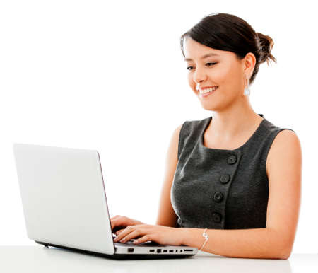 Business woman working online on a laptop - isolated over white  Stock Photo - 15288692