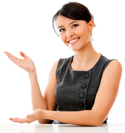 displaying: Business woman displaying something with her hands - isolated over a white background