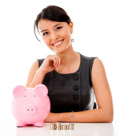 cash money: Mujer de negocios ahorrar dinero en una alcanc�a - aislados en un fondo blanco