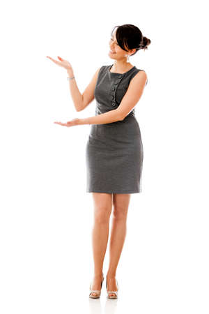introducing: Business woman presenting something - isolated over a white background  Stock Photo