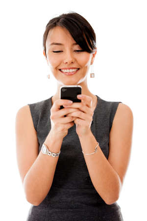 celulas humanas: Mujer de negocios texting en su tel�fono celular - aislados en un fondo blanco