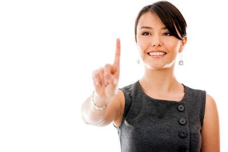 �cran tactile: Femme d'affaires touchant un �cran imaginaire - isol� sur un fond blanc