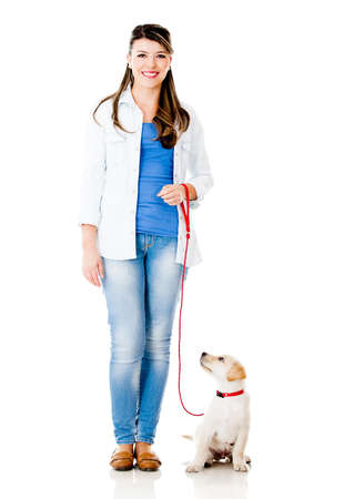 dog leash: Girl with a puppy dog on a leash - isolated over a white background