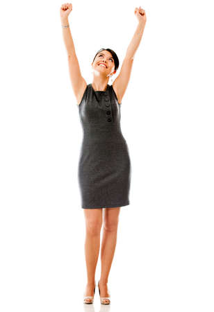 victory stand: Successful businesswoman celebrating with arms up - isolated over a white background  Stock Photo