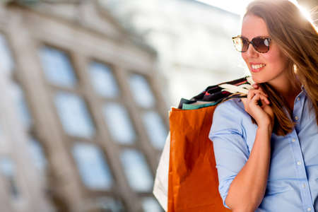 Beautiful shopping woman on a sunny summer day Stock Photo - 15515587