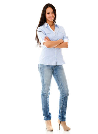 standing: Happy casual woman standing - isolated over a white background