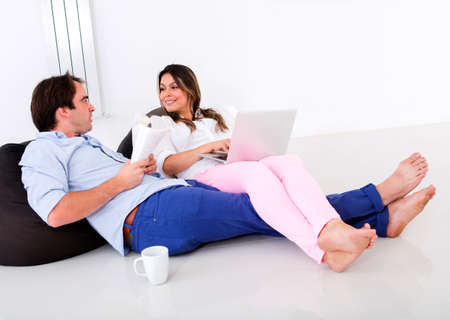 Couple at home spending time together talking  photo