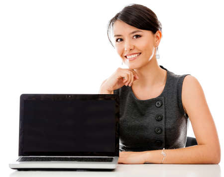 woman laptop happy: Business woman with a laptop facing the camera - isolated over white