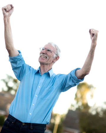 Successful senior man celebrating with arms up Stock Photo - 15458685