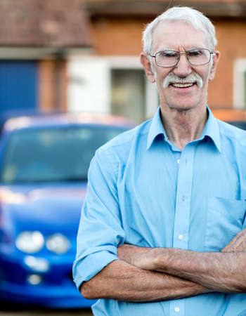 Happy senior man standing in front of his car  Stock Photo - 15458845