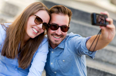 Couple of tourists on their holidays taking a self portrait  Stock Photo - 15427402