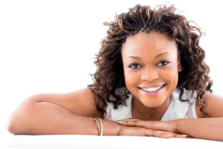 american content: Beautiful black woman smiling - isolated over a white background