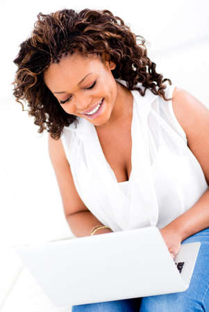 afro hairdo: Beautiful woman working on a laptop at home  Stock Photo